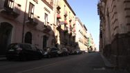 Stock Video Footage of Traffic in front of hotel in Catania city street.