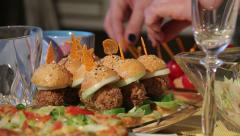 Women's hands are doing canapes. - stock footage