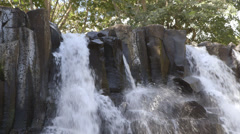 Water gushing over Basalt rocks Stock Footage