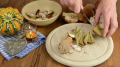 Cleaning penny bun  mushrooms with knife to cook a meal. Stock Footage