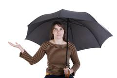 happy young woman standing under umbrella - stock photo
