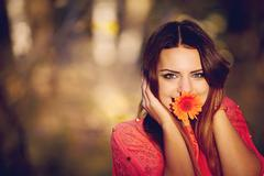 Girl with a flower in his mouth - stock photo