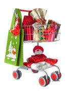Shopping cart full of christmas gifts Stock Photos