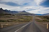 Stock Photo of highway through iceland landscape at overcast day