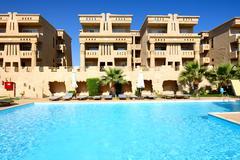 Sunbeds near swimming pool at luxury hotel, sharm el sheikh, egypt Stock Photos