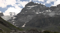 Snow capped mountains and rocks - Swiss Alps Stock Footage