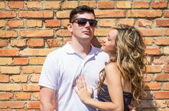 Couple portrait in front of brick wall Stock Photos