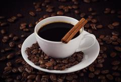 Kuppi kahvia kanelilla Kuvituskuvat