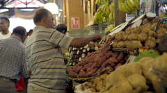 Man prepares exotic market stall Stock Footage