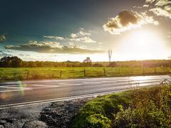 Country road at sundown Stock Photos