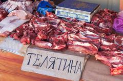 raw chopped meat ready for sale in local market. text in russian: veal - stock photo