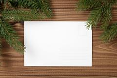 green spruce twig on wooden plank witc greeting card - stock photo