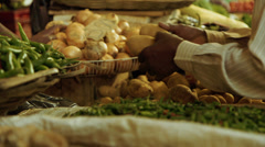 Man buying potatoes at vendor Stock Footage