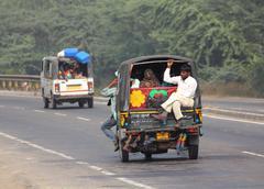 Auto rickshaw on indian road Stock Photos