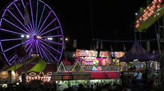 Midway Crowds With Ferris Wheel - stock footage