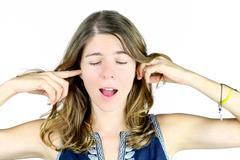 blocking her ears - stock photo