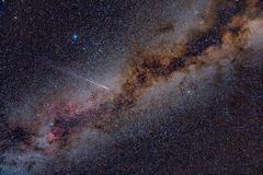 perseid meteor crossing the milky way - stock photo