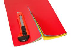 knife and color paper - stock photo