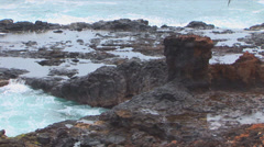 Waves Hitting Lava Rock Stock Footage