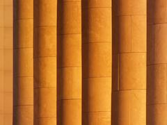 A sidelit colonnade as background - stock photo