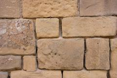 background image of a wall of irregular square wall - stock photo