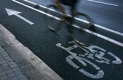 cyclist on urban cyceway - stock photo