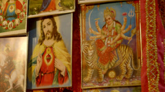 Religious items for sale at market stall Stock Footage