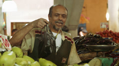 Vendor selling vegetables Stock Footage