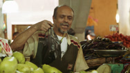 Stock Video Footage of Vendor selling vegetables