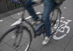 commuters on cycle lane - stock photo