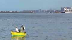 Men rowing a canoe in Alexandria, Egypt - stock footage