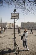 Woman with antique bike on lustgarten Stock Photos