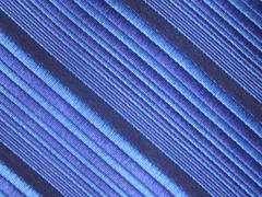 A striped silky textile with diagonal pattern - stock photo