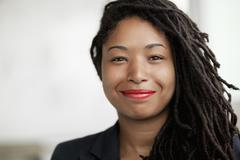 Portrait of smiling businesswoman with dreadlocks, head and shoulders Stock Photos