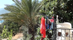 Washed clothes dry at the balcony 2 Stock Footage