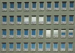 Green facade of a building - stock photo