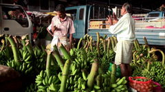 Sales of green unripe bananas in the wholesale farmers market. Stock Footage