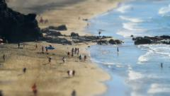 Beach live surfers walk tilt shift time lapse 11137 Stock Footage