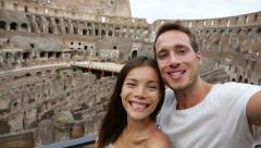 Tourist couple on travel in Rome in Coliseum Stock Footage