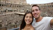 Stock Video Footage of Tourist couple on travel in Rome in Coliseum