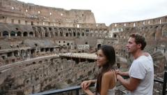 Coliseum - tourist couple on travel in Rome, Italy Stock Footage
