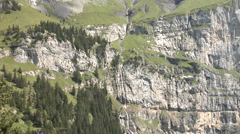 Swiss Alps - mountain stream flows into the lake. Stock Footage