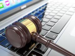 Online auction. gavel on laptop. 3d Stock Illustration