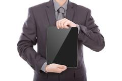 Business man using a touch screen device against white background Stock Photos