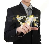 Business man touching an imaginary screen of social network against white bac Stock Photos