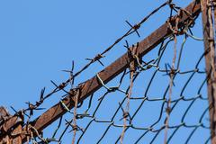 Rusty old fences of barb wire Stock Photos