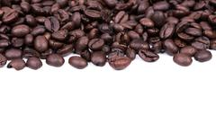 Brown coffee beans isolated on white background Stock Photos