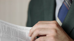 Businessman Reading The Bible Stock Footage