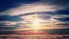 Brilliant sun rising from sea of clouds time lapse Stock Footage