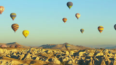 Lots of hot air balloons flying over valleys in Goreme, Cappadocia, Turkey. Stock Footage